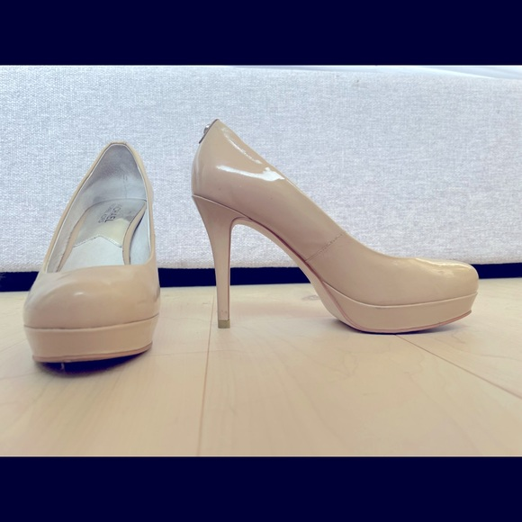 Michael Kors shoes (heels) too small for me.